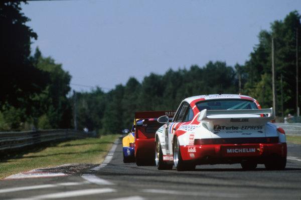 Le Mans, France. 18th - 19th June 1994.Jesus Pareja/Dominique Dupuy/Carlos Palau (Porsche Carrera RSR), 8th position, action. World Copyright: LAT Photographic.Ref:  94LM09.