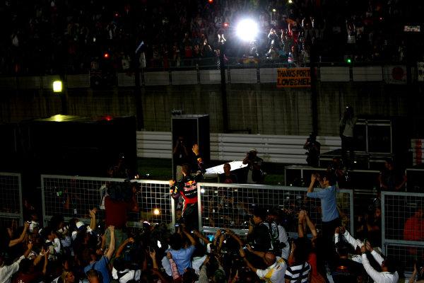 Suzuka Circuit, Suzuka, Japan.9th October 2011.Sebastian Vettel, Red Bull Racing RB7 Renault, 3rd position, celebrates his second world championship with his team. Portrait. Atmosphere. World Copyright: Andy Hone/LAT Photographicref: Digital Image CSP26109
