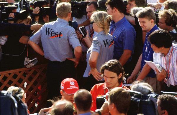 Suzuka, Japan.6-8 October 2000.Michael Schumacher (Ferrari) and Mika Hakkinen (McLaren Mercedes) both getting interviewed.World copyright - LAT Photographic