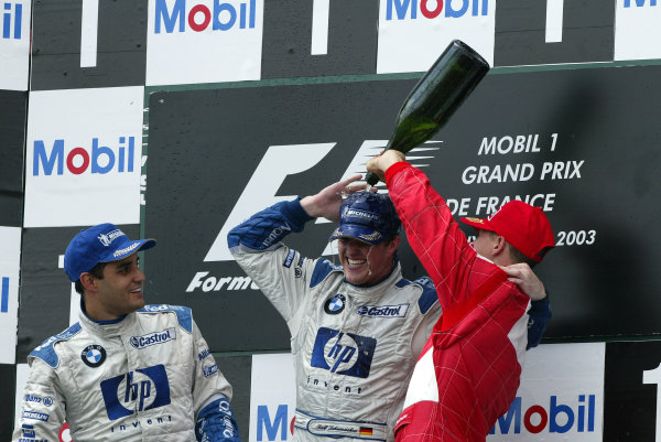 2003 French Grand Prix - Sunday Race,Magny Cours, France. 06th July 2003 Race podium, Ralf Schumacher, BMW Williams FW25, (1st), Juan-Pablo Montoya (2nd) and Michael Schumacher, Ferrari F2003 GA, (3rd).World Copyright: Steve Etherington/LAT Photographic ref: Digital Image Only