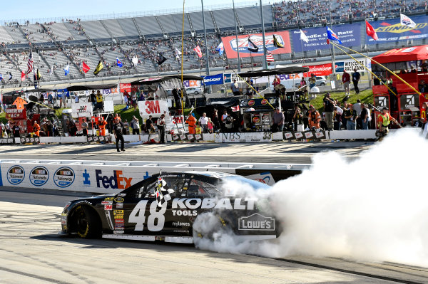 30 May-1 June, 2014, Dover, Delaware USA Jimmie Johnson celebrates his win with a burnout ? 2014, Nigel Kinrade LAT Photo USA