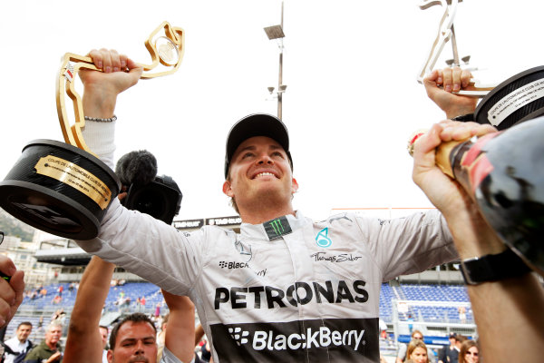 Monte Carlo, Monaco. Sunday 25 May 2014. Nico Rosberg, Mercedes AMG, 1st Position, celebrates with his team. World Copyright: Charles Coates/LAT Photographic. ref: Digital Image _N7T0208