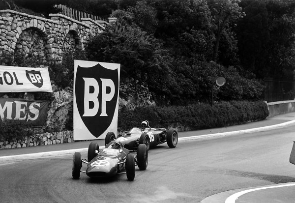 1962 Monaco Grand Prix.Monte Carlo, Monaco. 31 May-3 June 1962.Jack Brabham (Lotus 24-Climax) leads Phil Hill (Ferrari Dino 156) into the Old Station Hairpin. Hill finished in 2nd position.World Copyright: LAT PhotographicRef: Autosport b&w print