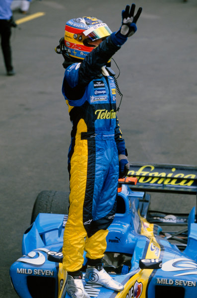 2005 European Grand Prix Nurburgring, Germany. 27th - 29th May. Fernando Alonso, Renault R25 celebrates his victory whilst standing on his car in parc ferme after the race World Copyright: Charles Coates/LAT Photographic ref: 35mm Image: 05Monaco08