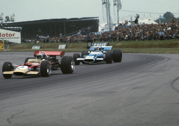 Silverstone, Great Britain. 19 July 1969.Jochen Rindt, Lotus 49B-Ford, 4th position, leads Jackie Stewart, Matra MS80-Ford, 1st position, action.World Copyright: LAT PhotographicRef: Colour Transparency.