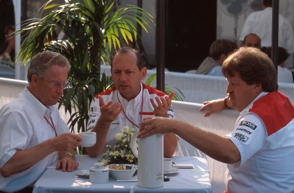 l-r, Jurgen Schremp, Ron Dennis and Norbert Haugh discuss McLarens tactics over breakfast.