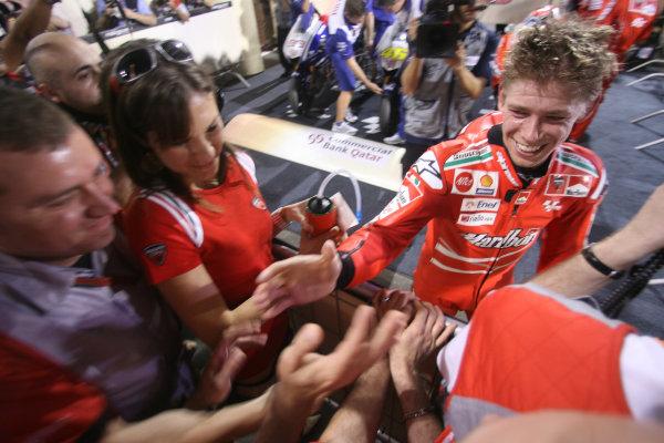 Qatar, Losail International Circuit.10th - 13th April 2009.Casey Stoner Marlboro Ducati Team celebrates his win in parc ferme.World Copyright: Martin Heath/LAT Photographicref: Digital Image BPI_Moto 7o5t
