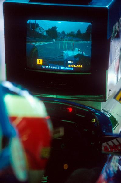 Spa-Francorchamps, Belgium.25-27 August 1995.Michael Schumacher (Benetton Renault) follows Damon Hill's progress through qualifying on his monitor.Ref-95 BEL 19.World Copyright - LAT Photographic