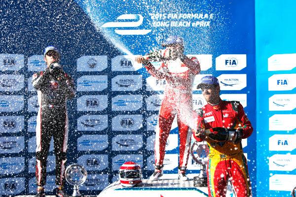 2014/2015 FIA Formula E Championship. Long Beach ePrix, Long Beach, California, United States of America. Sunday 5 April 2015 Podium. Nelson Piquet Jr (BRA)/China Racing - Spark-Renault SRT_01E, first, Jean-Eric Vergne (FRA)/Andretti Motorsport - Spark-Renault SRT_01E, second and Lucas di Grassi (BRA)/Audi Abt Sport - Spark-Renault SRT_01E, third. Photo: Zak Mauger/LAT/Formula E ref: Digital Image _L0U8747