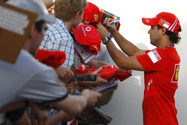 2008 Australian Grand Prix - Saturday QualifyingAlbert Park, Melbourne, Australia.15th March 2008Felipe Massa, Ferrari F2008, signs a fans cap. Portrait. Atmosphere. World Copyright: Charles Coates/LAT Photographicref: Digital Image _26Y6190