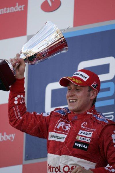 2007 GP2 Series Round 5. Silverstone, England. 8th July 2007. Sunday Race.Adam Carroll (GBR, Petrol Ofisi FMS International) celebrates victory on the podium. World Copyright: Andrew Ferraro/GP2 Series Media Service.ref: Digital Image _F6E6883