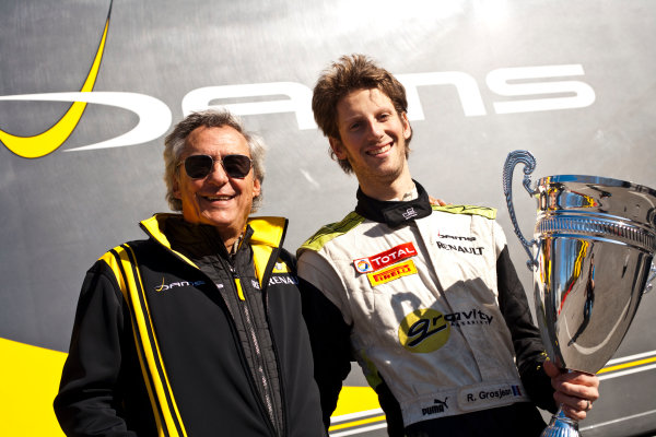 Imola, Italy. 20th March 2011. Sunday Race.Romain Grosjean, (FRA, Dams) celebrates victory in the Championship with Jean Paul Driot, (team owner).Portrait.     World Copyright: Drew Gibson/GP2 Media Service.ref: Digital Image _Y8P0615