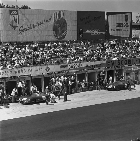 Nurburgring, Germany. 1st June 1958. Stirling Moss/Jack Brabham (Aston Martin DBR1), 1st position, leads Peter Collins/Mike Hawthorn (Ferrari 250 TR58), 2nd position, during their pit stops and driver changes, action. World Copyright: LAT Photographic. Ref: 1751.