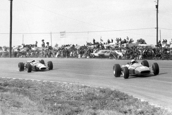 1966 United States Grand Prix.Watkins Glen, New York, USA.30/9-2/10 1966.Lorenzo Bandini (Ferrari 312), retired, leads Jim Clark (Lotus 43 BRM) 1st position, action.Ref-B/W PrintWorld Copyright - LAT Photographic