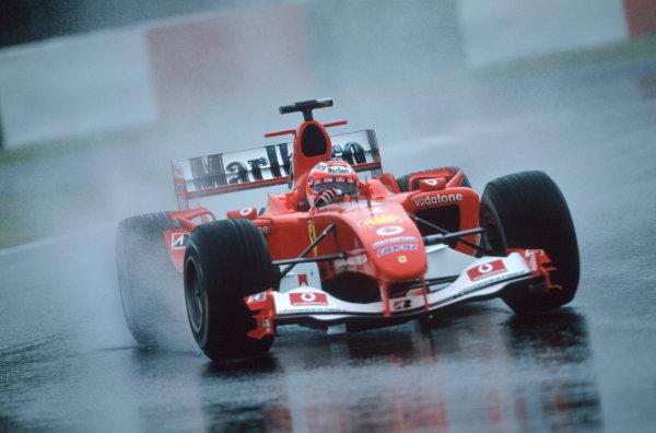 2004 Japanese Grand Prix.Suzuka , Japan 8th - 10th October 2004Rubens Barrichello, Ferrari F2004. Action. World Copyright:Lorenzo Bellanca/LAT Photographic ref: 35mm Image: A01