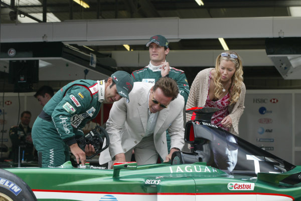 2003 British Grand Prix - Sunday Race,2003 British Grand Prix Silverstone, Britain. 20th July 2003.Arnold Schwartzenegger, Antonio Pizzonia and Mark Webber.World Copyright: Steve Etherington/LAT Photographic ref: Digital Image Only