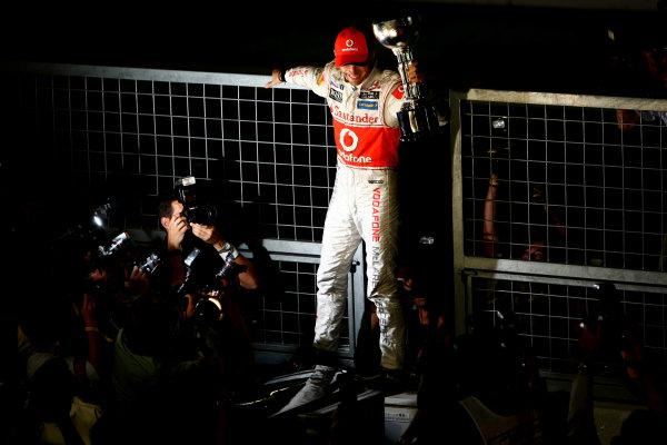Suzuka Circuit, Suzuka, Japan.9th October 2011.Jenson Button, McLaren MP4-26 Mercedes, 1st position, celebrates with his trophy. Portrait. World Copyright: Andy Hone/LAT Photographicref: Digital Image CSP25854