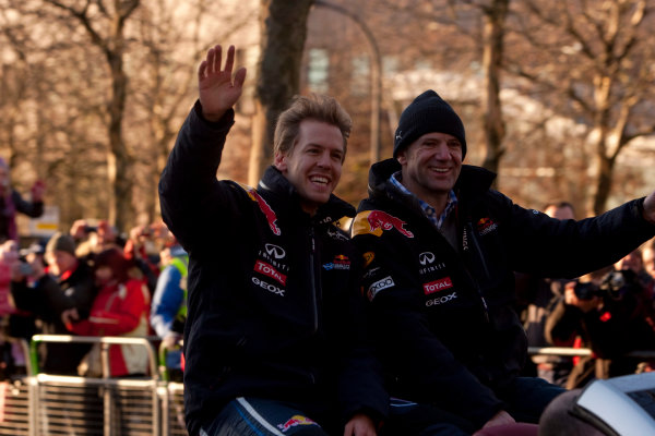 Milton Keynes.  Saturday 10th December 2011.Sebastian Vettel, Red Bull Racing RB7 Renault and Adrian Newey, Chief Technical Officer, Red Bull Racing wave to the crowd.  Photo: Alastair Staley/LAT Photographic.Ref: Digital Image _O9T5446 jpg