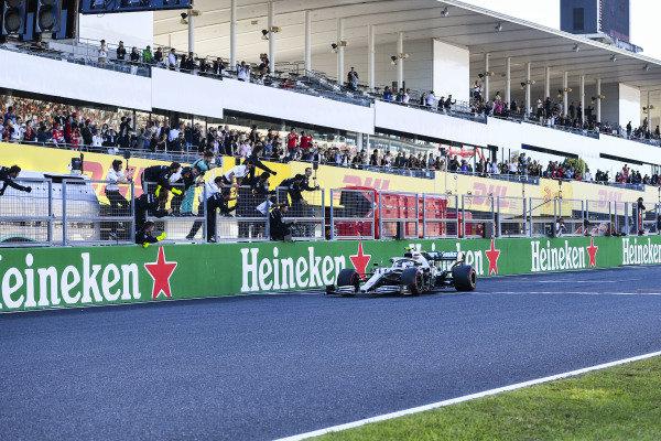 Race winner Valtteri Bottas, Mercedes AMG W10 crosses the finish line