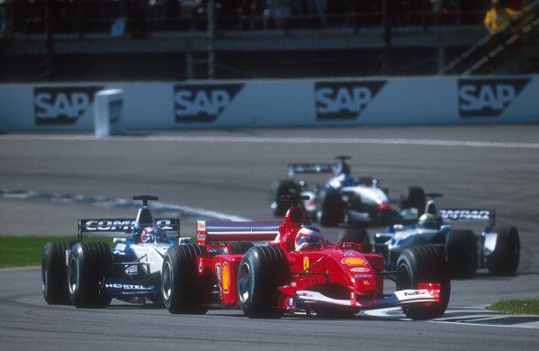 2001 United States Grand Prix.Indianapolis, Indiana, USA.28-30 September 2001.Rubens Barrichello (Ferrari F2001) closely followed by Juan-Pablo Montoya (Williams FW23 BMW).Ref-01 USA 03.World Copyright - LAT Photographic