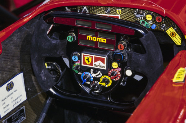 The steering wheel in one of the Ferrari F310Bs.