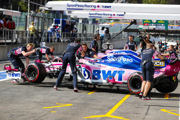 Sergio Perez, Racing Point RP19. anDrivers Lance Stroll, Racing Point RP19, stop outside of their pit garages