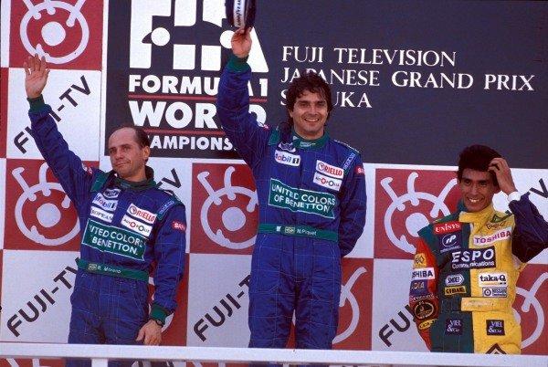 Roberto Moreno, Nelson Piquet, and Aguri Suzuki on the podium.