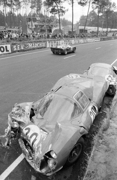 Bruce McLaren / Chris Amon, Shelby American Inc., Ford Mk II, passes the wreckage of Ludovico Scarfiotti / Mike Parkes' SpA Ferrari SEFAC, Ferrari 330 P3, and Georges Heligouin / Jean Rives' S.E.C. Automobiles C.D., C.D. SP66 - Peugeot 204.