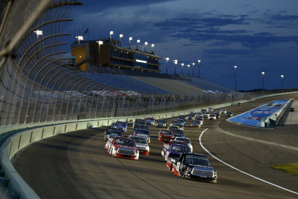 Christian Eckes, Kyle Busch Motorsports Toyota Safelite AutoGlass, leads a pack, Copyright: Michael Reaves/Getty Images.