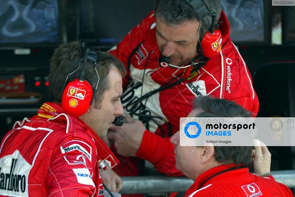 (L to R): Stefano Domenicali (ITA) Ferrari Director of F1 Racing Activities, Nigel Stepney (GBR) Ferrari Race Technical Manager and Jean Todt (FRA) Ferrari General Manager chat. Formula One World Championship, Rd6, Austrian Grand Prix, Race Day, A1-Ring, Austria, 18 May 2003. DIGITAL IMAGE