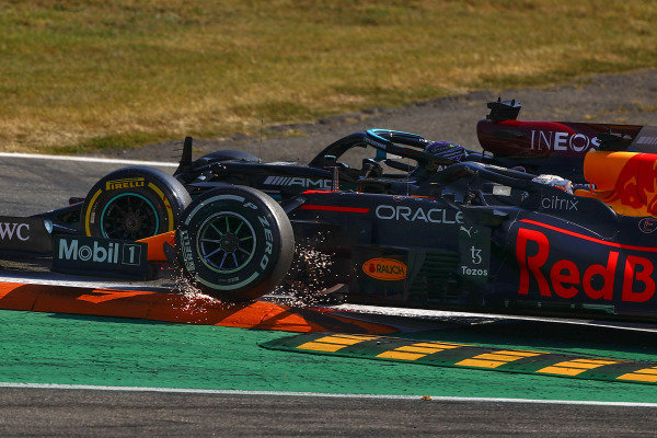 Sir Lewis Hamilton, Mercedes W12, and Max Verstappen, Red Bull Racing RB16B, collide