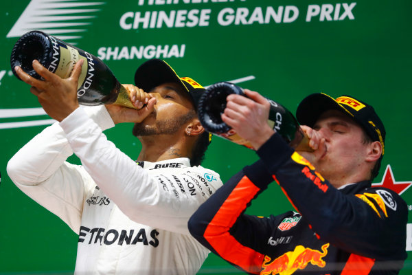 Shanghai International Circuit, Shanghai, China.  Sunday 09 April 2017.  Lewis Hamilton, Mercedes AMG, 1st Position, and Max Verstappen, Red Bull, 3rd Position, celebrate with Champagne on the podium. World Copyright: Steven Tee/LAT Images  ref: Digital Image _O3I5584