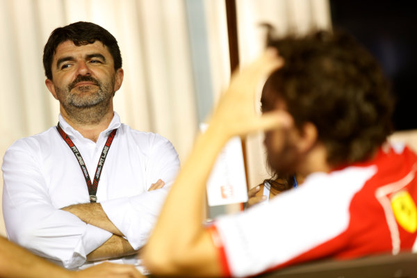 Marina Bay Circuit, Singapore. Friday 20th September 2013. Luis Garcia Abad, Manager of Fernando Alonso, in the paddock with Fernando Alonso, Ferrari. World Copyright: Charles Coates/LAT Photographic. ref: Digital Image _N7T3242