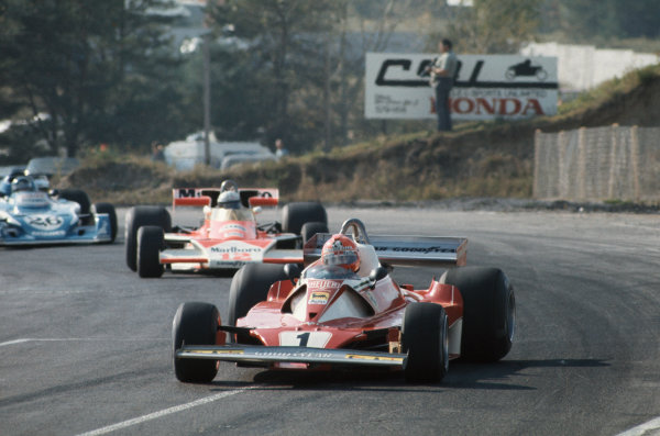 Mosport Park, Ontario, Canada. 1st - 3rd October 1976. Niki Lauda (Ferrari 312T2), 8th position leads Jochen Mass (McLaren M23-Ford), 5th position and Jacques Lafitte (Ligier JS5-Matra), retired, action.   World Copyright: LAT Photographic. Ref:  76 CAN 18.