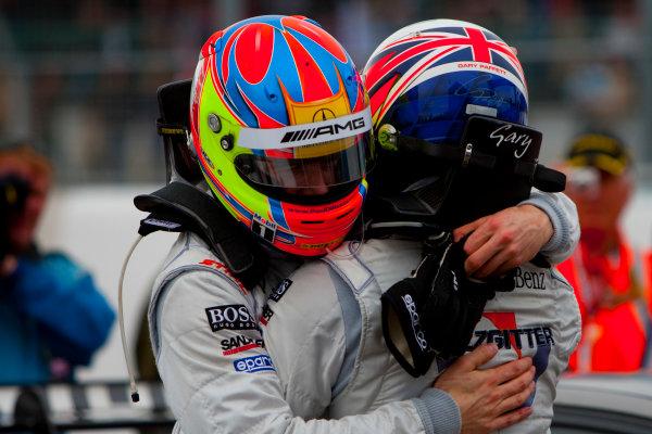 Dijon - Prenois, France. Sunday 11th October. Gary Paffett (Salzgitter AMG Mercedes C-Klasse) celebrates his victory with Paul Di Resta (AMG Mercedes C-Klasse). World Copyright: Alastair Staley/LAT Photographic.Ref: _O9T0651 jpg