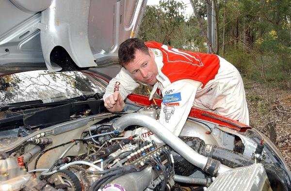 Colin McRae (GBR) Citroen attempts to resolve his brake problem between stages.