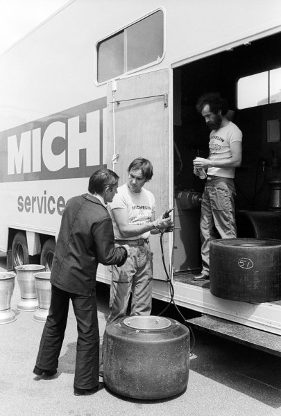 Pierre Dupasquier (FRA) Michelin, talks with Michelin engineers outside the Michelin Service truck in the paddock.