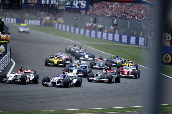 Takuma Sato, BAR 006 Honda leads Juan Pablo Montoya, Williams FW26 BMW and Mark Webber, Jaguar R5 Cosworth at the start.