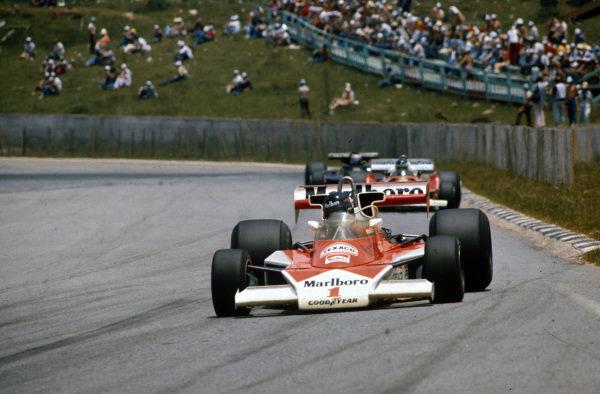 James Hunt, McLaren M23 Ford leads Carlos Reutemann, Ferrari 312T2.