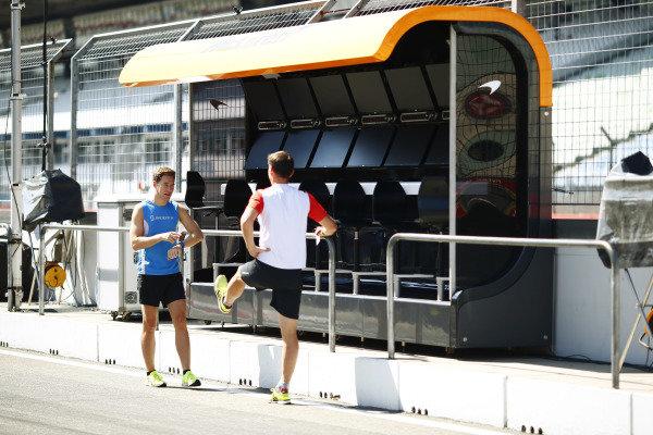 Stoffel Vandoorne, McLaren, prepares to go jogging with his trainer.