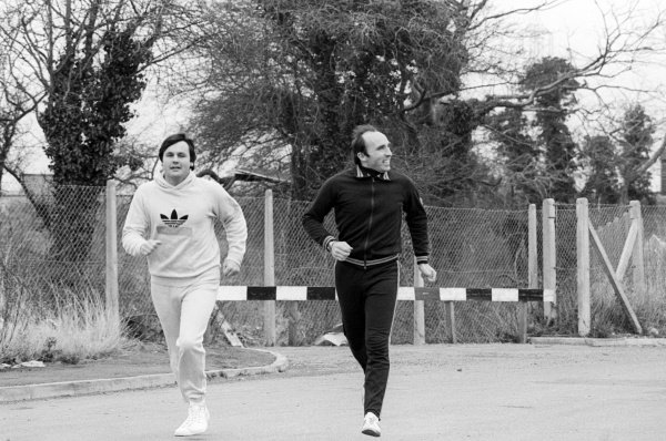 (L to R): Alan Jones (AUS) and his boss Frank Williams (GBR) Williams Team Owner enjoy a run around the company headquarters.Williams Grand Prix Engineering Factory, Didcot, Oxfordshire, c. March 1978.