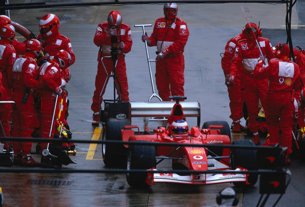 2002 British Grand Prix, Silverstone, England. 7th July 2002. Rubens Barrichello exits his pit as the rain starts to fall.World Copyright - LAT Photographic Ref: 35mm Original A15