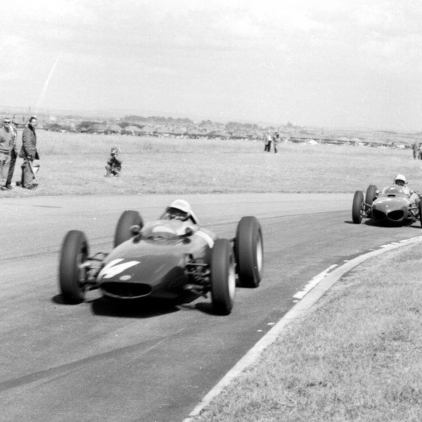 1962 British Grand Prix.Aintree, England.19-21 July 1962.Richie Ginther (BRM P57) leads Phil Hill (Ferrari Dino 156).Ref-14784.World Copyright - LAT Photographic