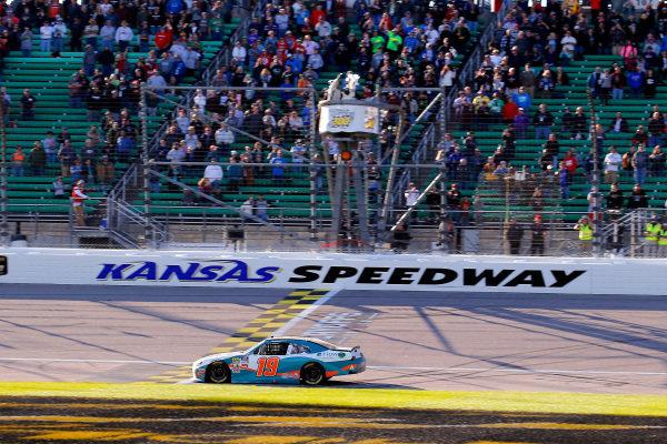 #19: Brandon Jones, Joe Gibbs Racing, Toyota Supra Flow drives under the checkered flag to win