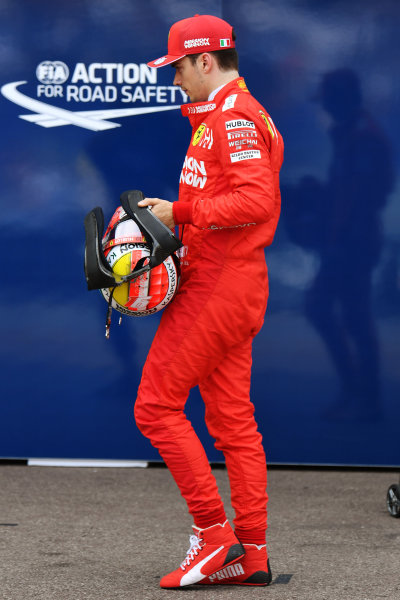 Charles Leclerc, Ferrari, walks in the pit lane after being knocked out of the first part of qualifying
