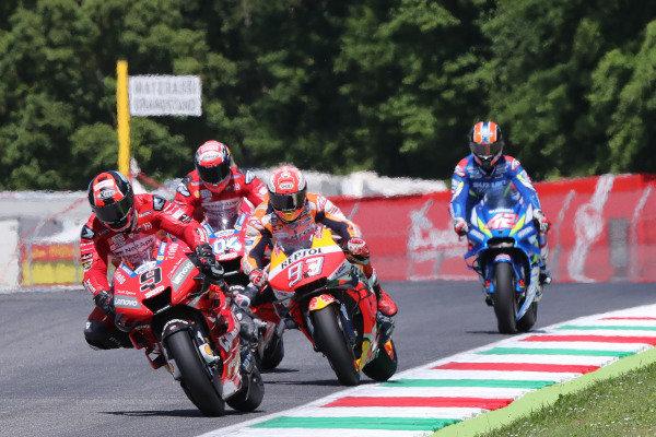 Danilo Petrucci, Ducati Team leads Marc Marquez, Repsol Honda Team.