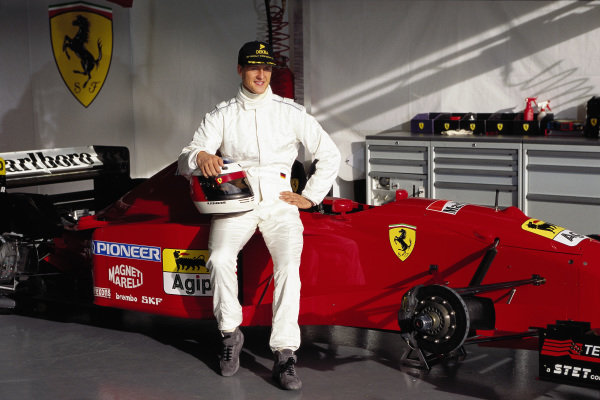 Test Estoril 1995. Michael Schumacher poses with a Ferrari 412T2 in plain white overalls.