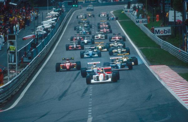 1992 Belgian Grand Prix.Spa-Francorchamps, Belgium.28-30 August 1992.Ayrton Senna (McLaren MP4/7A Honda) leads Nigel Mansell, Riccardo Patrese (both Williams FW14B Renault's), Jean Alesi (Ferrari F92A) and Michael Schumacher (Benetton B192 Ford) down to La Source Hairpin at the start.Ref-92 BEL 16.World Copyright - LAT Photographic