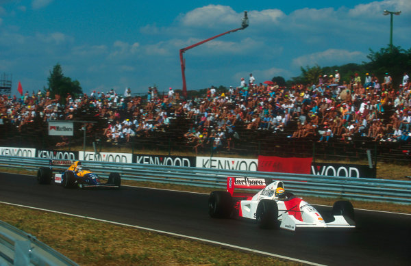 1992 Hungarian Grand Prix.Hungaroring, Budapest, Hungary.14-16 August 1992.Ayrton Senna (McLaren MP4/7A Honda) leads Nigel Mansell (Williams FW14B Renault). They finished in 1st and 2nd positions respectively.Ref-92 HUN 16.World Copyright - LAT Photographic