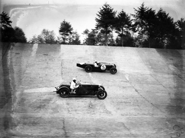 A Riley (#5) and a Frazer Nash in action on the banking.